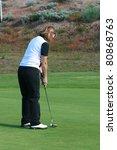blond female golfer putting on...   Shutterstock . vector #80868763