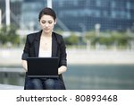 Business woman using a Laptop - stock photo