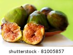 Ripe fruits of a fig on green background - stock photo