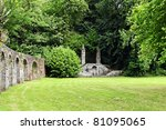 garden with stone walls from a abbey in france - stock photo