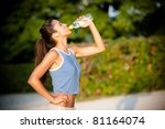slim young woman drinking water ... | Shutterstock . vector #81164074