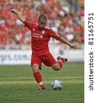KUALA LUMPUR - JULY 16 : Liverpool football club player Joe Cole kicks a ball during a friendly match against Malaysia XI on July 16, 2011 in Kuala Lumpur, Malaysia. Liverpool won 6-3. - stock photo