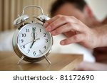 man lying in bed turning off an ... | Shutterstock . vector #81172690