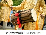 musician playing a traditional asian dhol drum - stock photo
