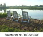 beauty lake and armchairs - stock photo