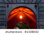 warmly lit entrance to the castle - stock photo