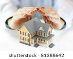 Hands and house model - stock photo