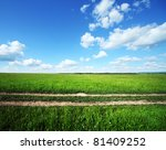 Rural Road In Green Meadow And...