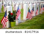 Stock photo us military cemetery flying the us flags 81417916