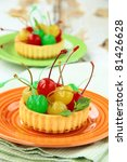 dessert tartlet with colored cocktail cherries - stock photo
