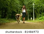 Stock photo elegant woman walking her big dog in the park 81486973
