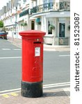 Red British Mail Box On A City...