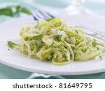 Zucchini Spaghetti with cheese, garlic and basil. Selective focus - stock photo