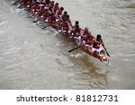 Small photo of KOTTAYAM, INDIA - AUGUST 29 : Oarsmen in a snake boat team row vigorously in the Kottayam Boat race on August 29, 2010 in Kottayam, India.