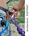 fixation with snap hook for abseiling - stock photo