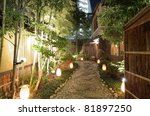 Lit gravel walkway at a Japanese Restaurant - stock photo