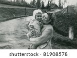 Vintage photo of mother and baby (fifties) - stock photo