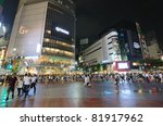 TOKYO, JAPAN - JULY 19: Shibuya crossing is one of the largest and most famed examples of a scramble crosswalk in the world on July 19, 2011 in Tokyo, Japan. - stock photo