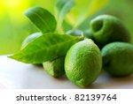 Green lemons group. - stock photo