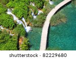 wood walkway and small waterfalls  in Plitvicka Jezera national park, Croatia. - stock photo
