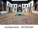 Interior of tiled courtyard with fountain of madrasah, Muslim school in Meknes, Morocco - stock photo