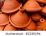 Pile of clay tangine cooking pots in Medina, marketplace, Meknes, Morocco. - stock photo