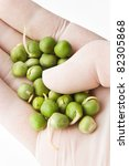 analyzing peas in hand with... | Shutterstock . vector #82305868