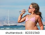 Girl drinking water from the bottle - stock photo
