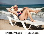 Pin Up Girl Relaxing On A Beach