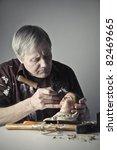 Senior Artist Restoring A...