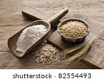 whole grain and flour on wooden ... | Shutterstock . vector #82554493