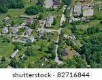 aerial view over small village | Shutterstock . vector #82716844
