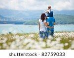 happy family having fun outdoors | Shutterstock . vector #82759033