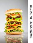 Tasty and appetizing hamburger on a grey background - stock photo