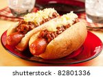 Perfect for the big game,  picnic, party or anytime, chili dogs with sauerkraut. - stock photo