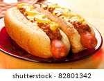 Perfect for the big game,  picnic, party or anytime, chili cheese dogs with mustard and onions - stock photo