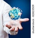 dollar earth globe in his hands