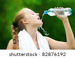 young woman drinking water... | Shutterstock . vector #82876192