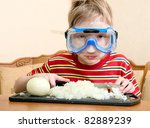 the child cuts the onions. he...