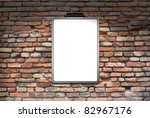 Space brick wall with posters of the lighthouse lit - stock photo