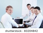 Young people with a laptop in the office - stock photo