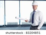A man in a helmet on a construction site - stock photo