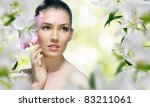a beautiful girl in the flower... | Shutterstock . vector #83211061