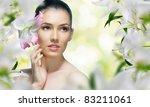 a beautiful girl in the flower... | Shutterstock . vector #83211061