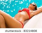 Sexy girl sunbathing on the beach - stock photo