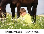 teenager boy hugging brown horse | Shutterstock . vector #83216758