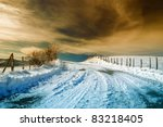 road with cool sunset and snow - stock photo
