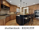 Stock photo luxury kitchen with granite island and wood cabinetry 83241559