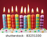 Ten Colorful Candles On Red...
