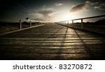 Sun setting over jetty on the Australian coastline - stock photo